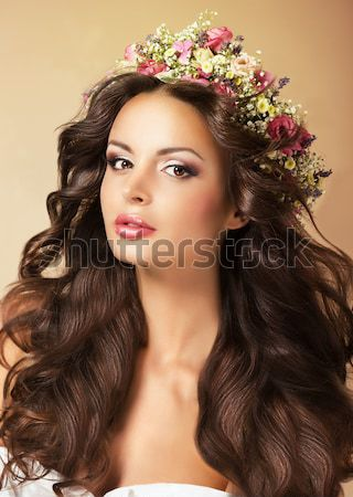 Portrait of Young Auburn Woman with Long Flowing Hairs and Wildflowers Stock photo © gromovataya