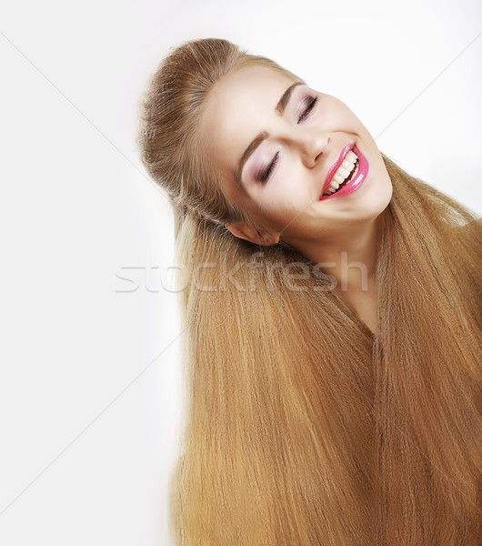 Sincere Smile. Jubilant Young Woman with Flowing Healthy Hairs. Pleasure Stock photo © gromovataya