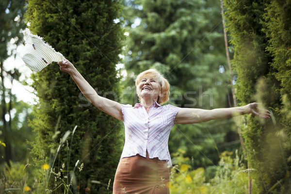 Freedom. Happy Old Lady with Hut smiling in The Garden. Lifestyle Stock photo © gromovataya