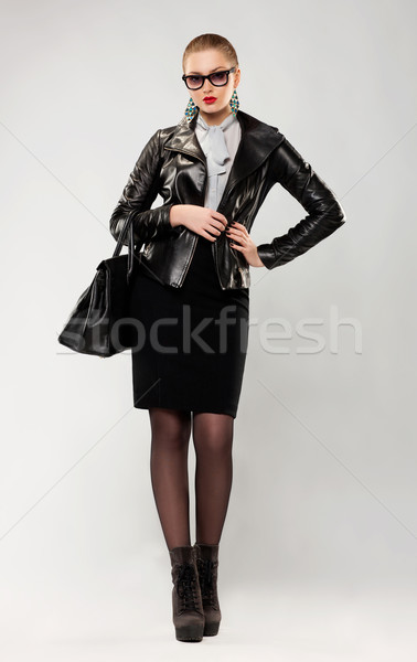 Fashionable confident trendy woman in sunglasses and handbag Stock photo © gromovataya