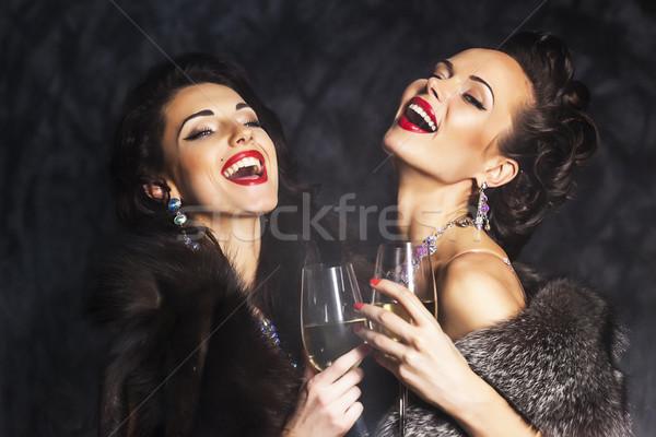 Young happy fashion women celebrating the event. Congrats! Stock photo © gromovataya