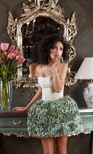 Coquette. Curly Hair Woman in Elegant Dress over Vintage Mirror Stock photo © gromovataya