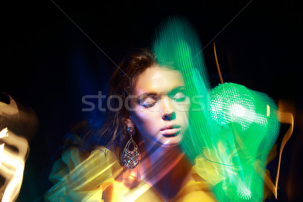 Flutter. Face of Woman in Blurry Colorful Lights. Metamorphose Stock photo © gromovataya