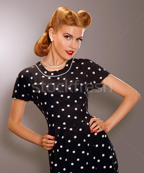 Romance. Styled Woman in Blue Retro Polka Dot Dress. Pin Up Style Stock photo © gromovataya