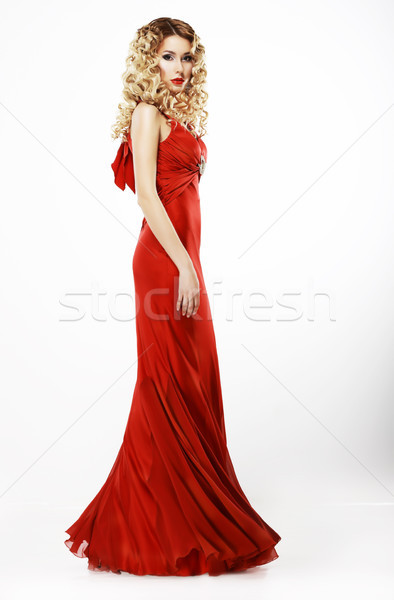 Luxury. Full Length of Elegant Lady in Red Satiny Dress. Frizzy Blond Hair Stock photo © gromovataya
