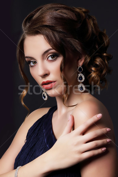 Luxurious Rich Lady with Stylish Earrings Stock photo © gromovataya