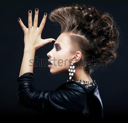 Strange stylish punk woman saluting and gesturing Stock photo © gromovataya