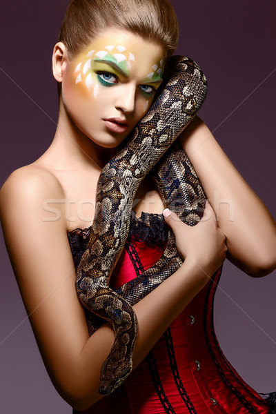 Beautiful Woman holding Python Snake in Hands - Performance Stock photo © gromovataya