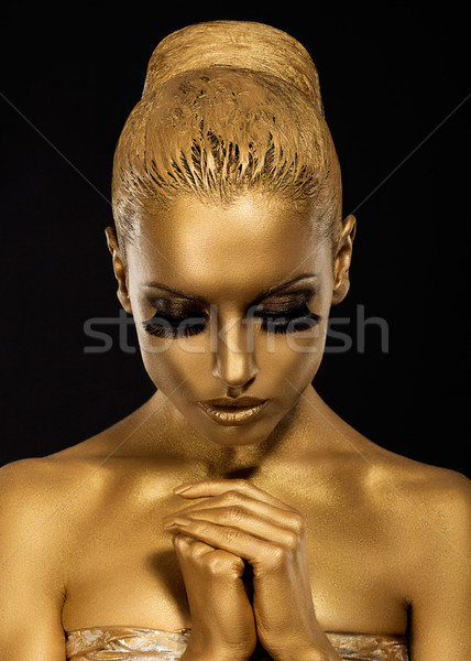 Belief. Styled Woman with praying hands. Golden Makeup Stock photo © gromovataya