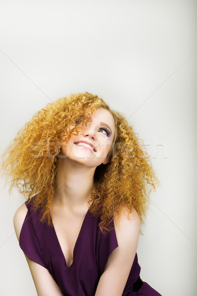 Lifestyle. Radiant Happy Woman with Curly Golden Hairs smiling. Positive Emotions Stock photo © gromovataya