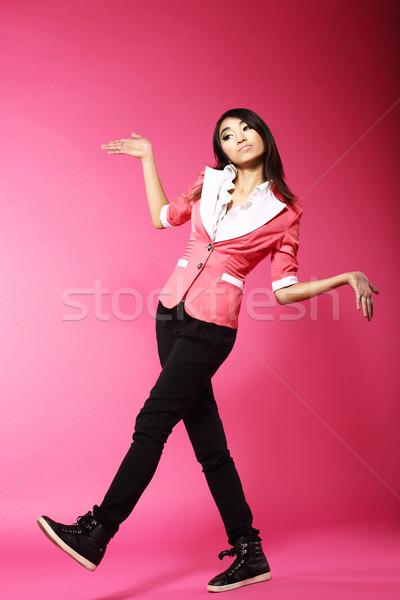 Asian Amusing Teenager Walking in Pink Studio Stock photo © gromovataya