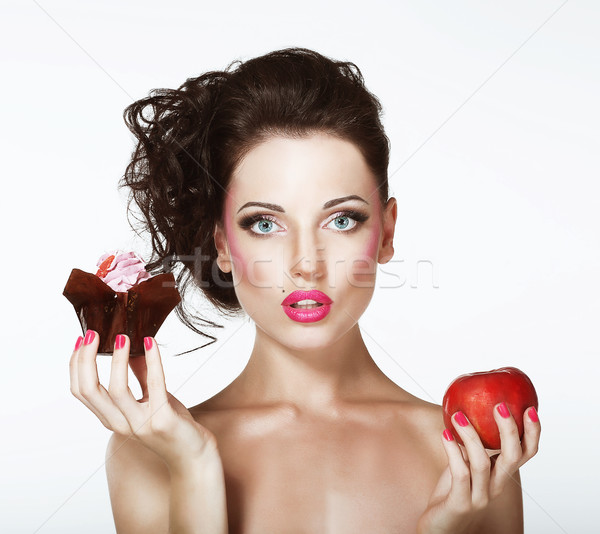 Dilemma. Diet. Undecided Woman with Apple and Cupcake Stock photo © gromovataya