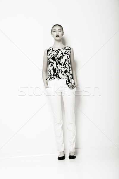 Glamour. Fashion Model in Modern White Trousers and Shirt. Elegance Stock photo © gromovataya