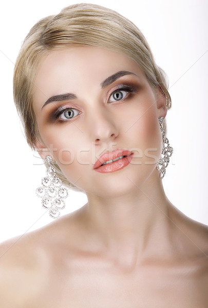 Magnetism. Portrait of Young Blond with Glossy Earrings Stock photo © gromovataya