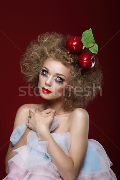 Artistry. Styled Woman with Two Apples on her Head Stock photo © gromovataya