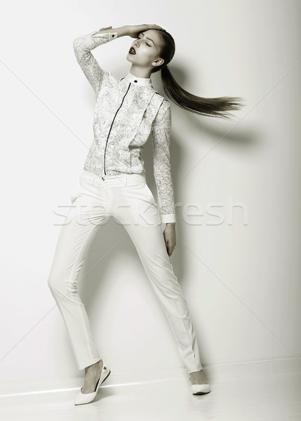 Expression. Futuristic Woman in White Trousers. Trend. Series of Photos of Urban Fashion Stock photo © gromovataya