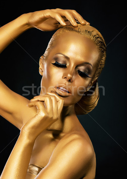 Glint. Coloring. Mysterious Woman with Golden Faceart. Creative Concept Stock photo © gromovataya