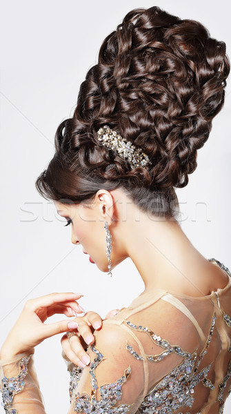 Luxury. Fashion Model with Trendy Updo - Braided Tress. Vogue Style Stock photo © gromovataya