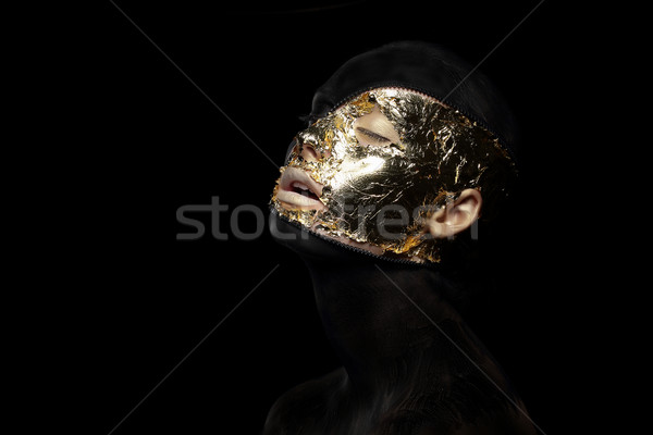Fiction. Imagination. Futuristic Creature in Crazy Mystic Mask and Gilt Stock photo © gromovataya