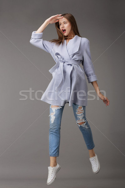 Emotional Young Woman in Outer Garments Stock photo © gromovataya