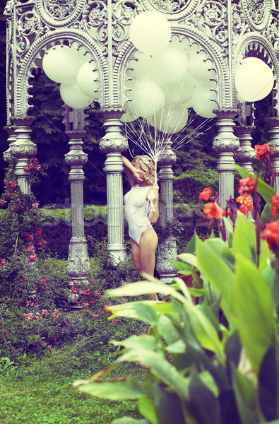Sentiment. Beautiful Relaxed Blonde holding Air Balloons in the Garden Stock photo © gromovataya