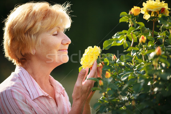 Expression. Senior Woman Model with Garden Roses. Springtime Stock photo © gromovataya