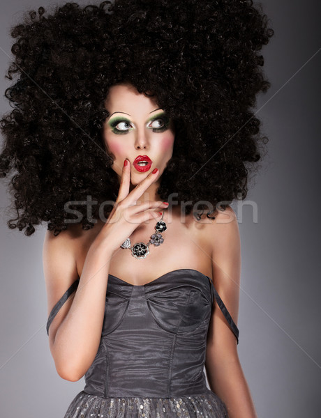 Vogue. Trendy Brunette in Lush Art Wig Grimacing. Creative Concept Stock photo © gromovataya