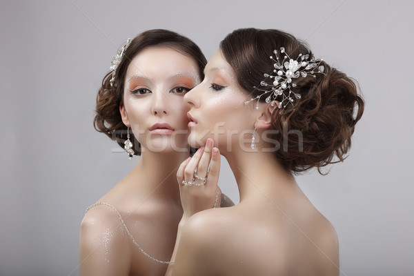 Vogue Style. Two Snazzy Women with Jewelry and Art Make-up Stock photo © gromovataya