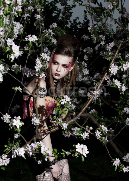 Lovely woman with creative make-up in garden Stock photo © gromovataya