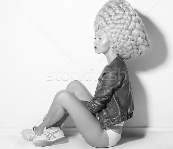 Vogue. Fanciful Eccentric Woman Fashion Model in Creative Periwig sitting Stock photo © gromovataya
