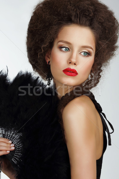 Character. Refined Exquisite Brunette holding Fan with Feather Stock photo © gromovataya