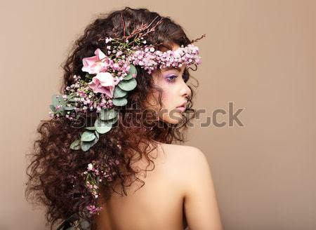 Sultry Beauty. Attractive Naked Woman with Long Curly Hair and Wreath of Flowers Stock photo © gromovataya