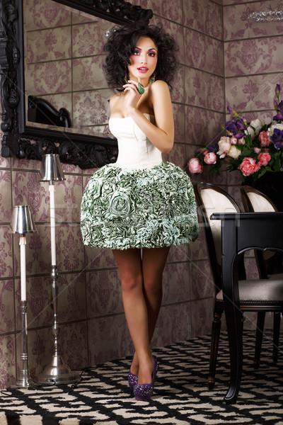 Luxury. Stylish Brunette standing in Trendy Dress. Modern Interior Stock photo © gromovataya