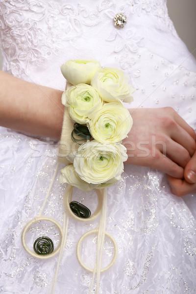 Arrangement. Bouquet of Flowers as a Bracelet on Woman's Hands. Floristics Stock photo © gromovataya