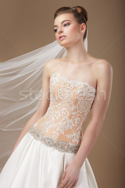 Elegantie jonge stijlvol slank vrouw gouden Stockfoto © gromovataya