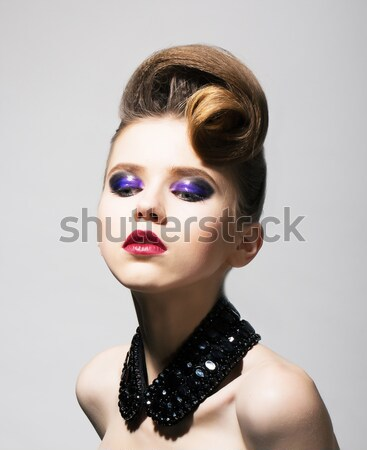 Imagination. Bright Young Woman with Blue Holiday Eye Makeup and Festive Hairstyle Stock photo © gromovataya