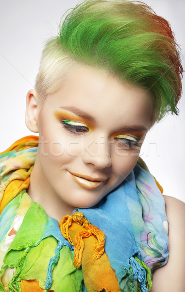 Young Woman with Colorful Makeup and Short Painted Coiffure Stock photo © gromovataya