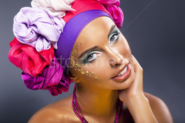Colorful shawl. Pretty woman face - bright gold make up Stock photo © gromovataya