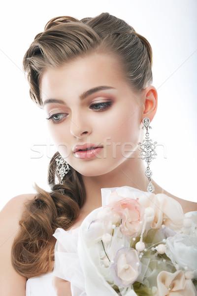 Pretty gentle fashion fiancee with flowers in studio Stock photo © gromovataya