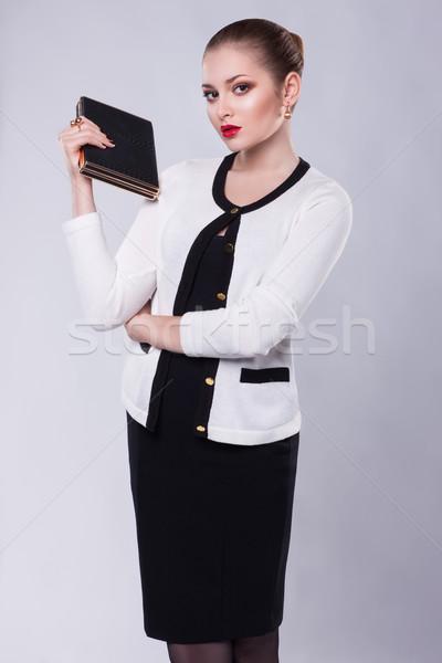 Fier jeunes femme d'affaires modernes costume livre Photo stock © gromovataya