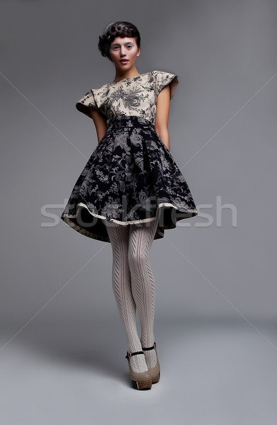 Supermodel fashionable brunette standing in grey dress Stock photo © gromovataya