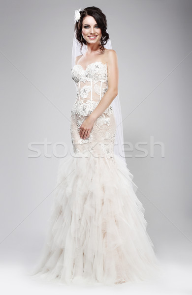 Stock photo: Wedding Style. Sophisticated Newlywed in White Bridal Dress. Elegance