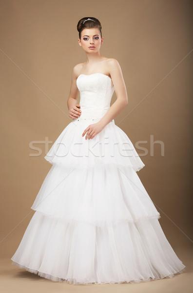 Caucasian Woman in White Long Dress Posing in Studio Stock photo © gromovataya