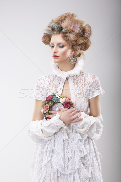 Personality. Luxurious Woman with Flowers in Evening Costume Stock photo © gromovataya