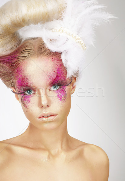 Showy Woman with Fuzzy Feathers and Fantastic Art Makeup Stock photo © gromovataya