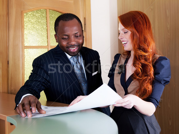 Red hair young businesswoman and black american businessman Stock photo © gromovataya