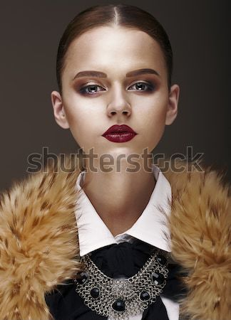 Arrogance. Stately Luxurious Woman in Wool Collar and Necklace Stock photo © gromovataya