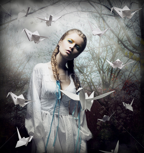 Imagination. Romantic Blonde with Hovering Origami Birds in Spooky Forest. Magic Stock photo © gromovataya