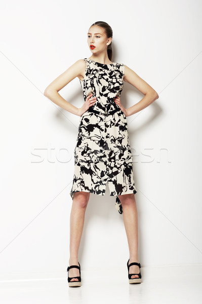 Simplicity. Woman in Ordinary Grey Spotted Summer Dress. Fashion. Series of photos Stock photo © gromovataya