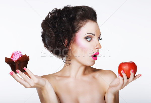 Surprised Funny Woman Decides between Apple and Cake Stock photo © gromovataya